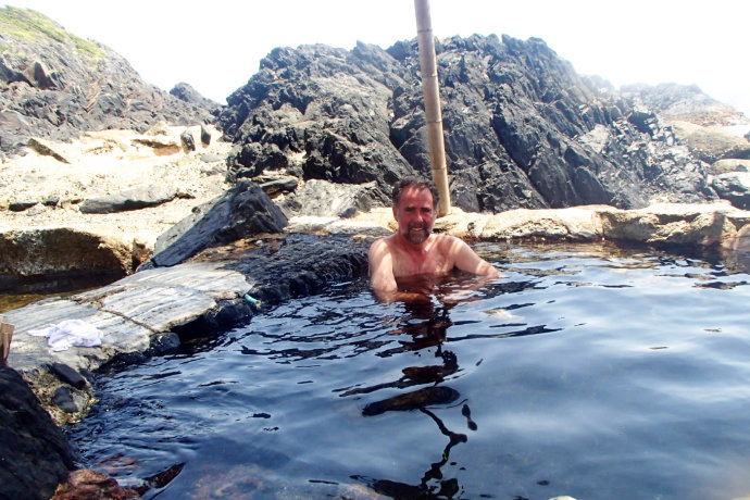 A photo of Kirk taking bath in outdoor onsen